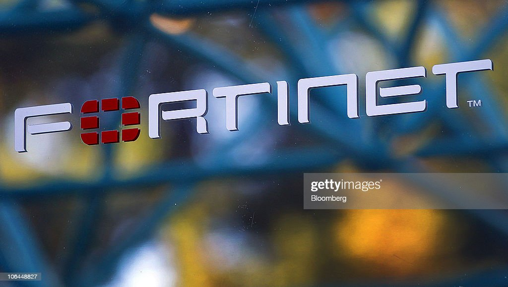 A building is reflected in signage outside