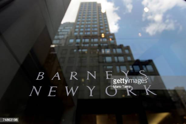 A building is reflected in the Barneys New York store window June 22 2007 in New York City Jones Apparel Group Inc plans to sell Barneys New York to...