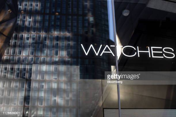 A building is reflected in the exterior of the Patek Philippe SA store at the Hudson Yards development in New York US on Tuesday March 5 2019 Driving...
