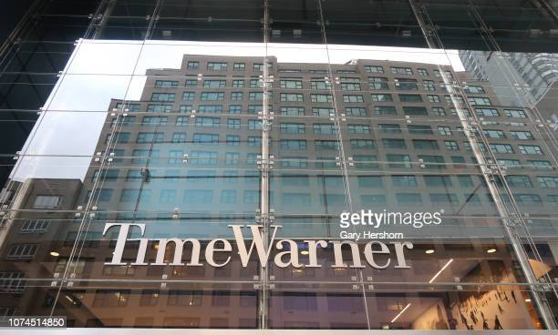 Building is reflected in the facade of the Time Warner Center in Columbus Cirlce on November 28 in New York City.