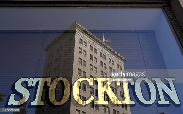Building is seen reflected in the window of the vacant Bank of Stockton on June 27, 2012 in Stockton, California. Members of the Stockton city...