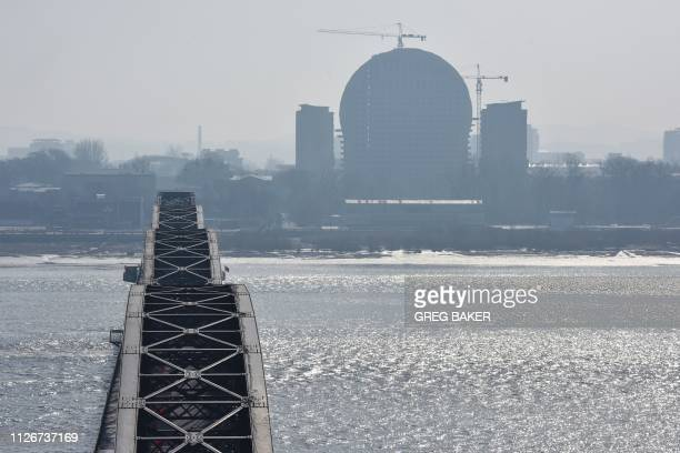Building is seen under construction in the North Korean town of Sinuiju, behind the Broken Bridge, which once spanned the Yalu River between China...