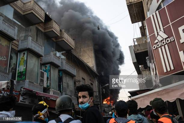 A building is set ablaze near Ahrar Bridge where there have been recent clashes between demonstrators and Iraq security forces on November 24 2019 in...