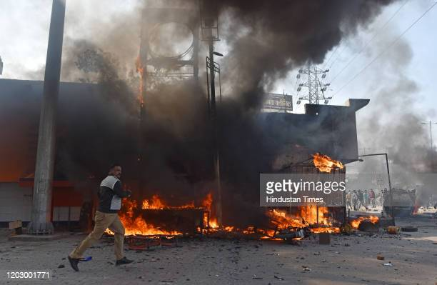 Building is set on fire during violent clashes between anti and pro CAA demonstrations at Bhajanpura on February 24, 2020 in New Delhi, India. A...