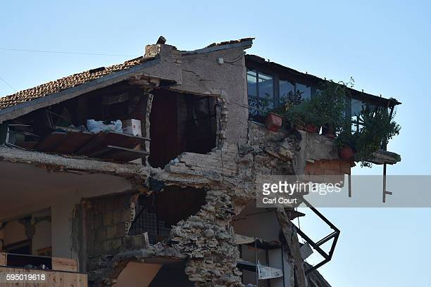 A building is severely damaged after being struck by an earthquake on August 25 2016 in Amatrice Italy The death toll in the 62 magnitude earthquake...
