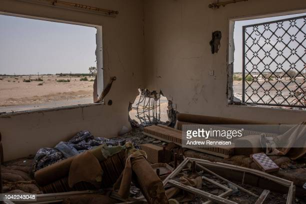 Building lays in ruins at a frontline position at Kilo 16, an area which contains the main supply route linking Hodeidah city to the rebel-held...