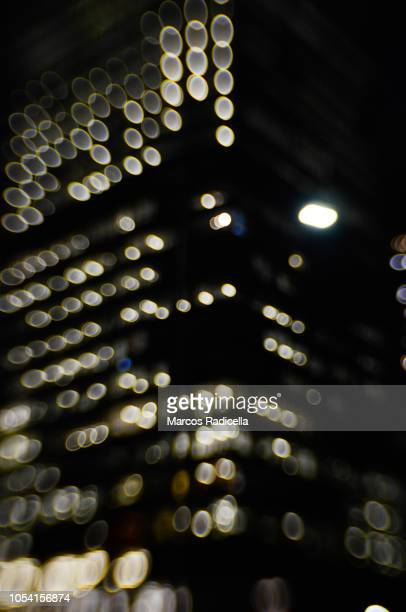 building lights at night - radicella stock pictures, royalty-free photos & images
