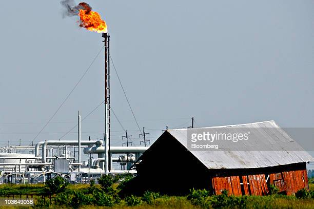 A building likely damaged by Hurricane Rita is seen as gas is flared off at the Henry Hub natural gas pipeline facility owned and operated by Sabine...