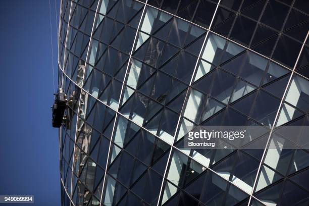 A building maintenance cradle hangs from 30 St Mary Axe also known as 'the Gherkin' in the City of London UK on Friday April 20 2018 Foreign...