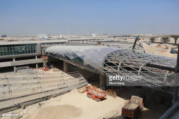 Building materials sit near the passenger departures entrance at Abu Dhabi airport's MidField terminal during construction in Abu Dhabi United Arab...