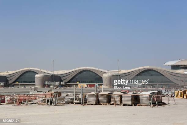 Building materials sit on the aircraft runway area outside Abu Dhabi airport's MidField terminal during construction in Abu Dhabi United Arab...