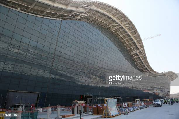 Building materials sit outside Abu Dhabi airport's MidField terminal during construction in Abu Dhabi United Arab Emirates on Monday Nov 6 2017 The...