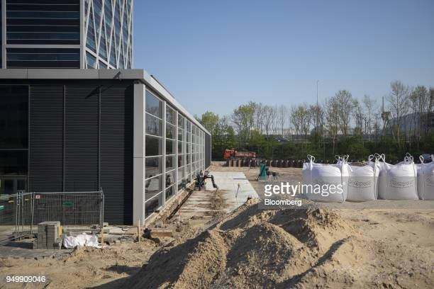 Building materials stand at the construction site for European Medicines Agency 's new offices in Amsterdam Netherlands on Friday April 20 2018...