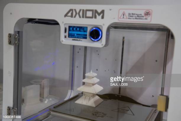 A building model sits inside a 3Dprinter after it was completed at ABC Imaging in Washington DC on August 1 2018 A US judge on July 31 2018...