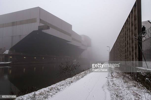 A building of the steel factory Thy Marcinelle lies along the river Sambre after a snowfall
