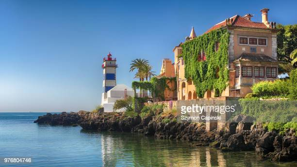 building on coast, cascais, portugal - cascais stock photos and pictures