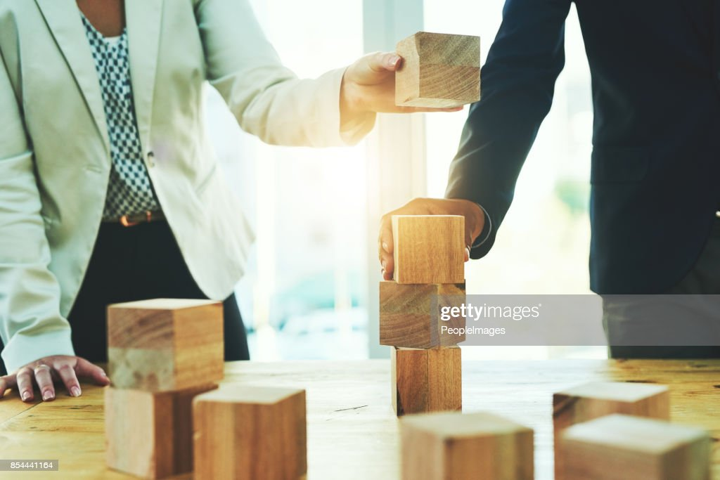 Building on their success together : Stock Photo