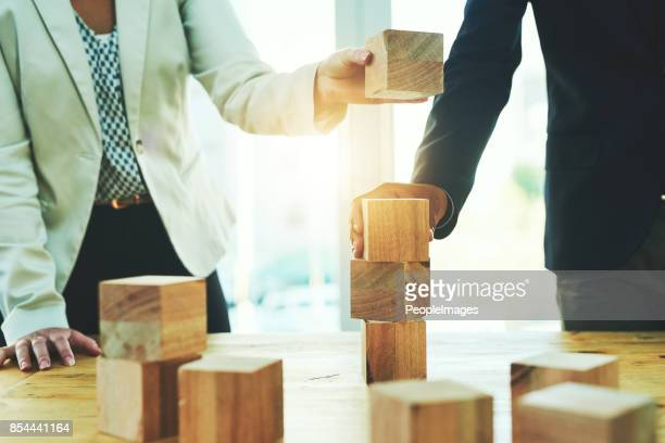 building on their success together - toy block stock pictures, royalty-free photos & images