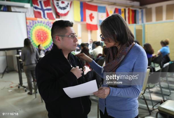 Building One Community director Catalina Horak speaks with an immigrant at a DACA and TPS workshop on January 27 2018 in Stamford Connecticut The...