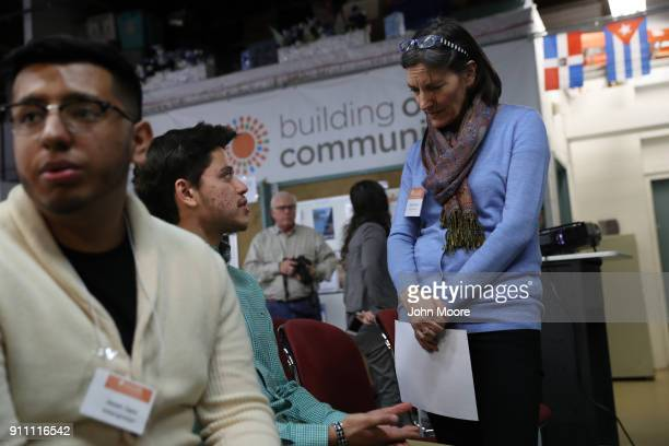 Building One Community director Catalina Horak speaks with Honduran immigrant Michael Hernandez at a DACA and TPS workshop on January 27 2018 in...