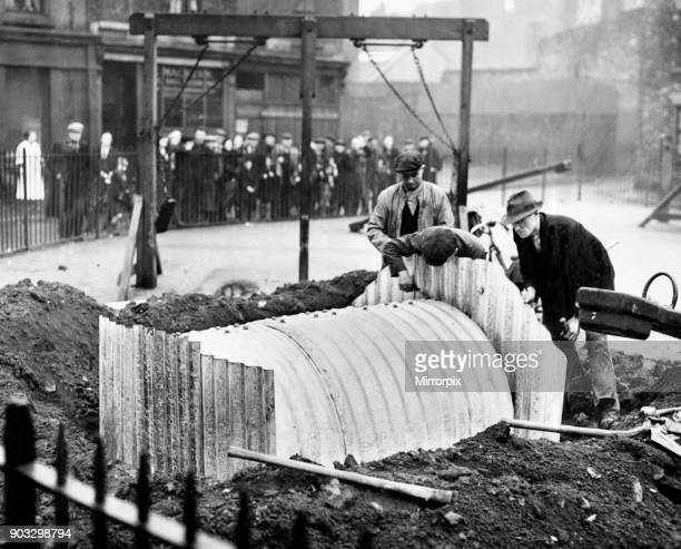 Building one of the shelters at the children's playground, Pownall Square, Pall Mall, Liverpool. 4th March 1939.