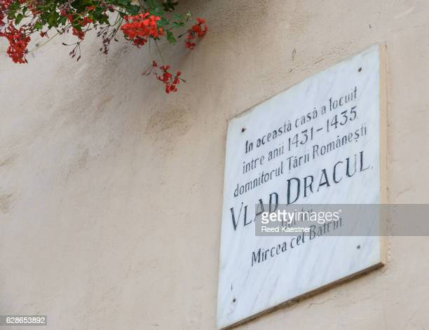 Building plaque commemorating that 'Vlad the Impaler' lived here many years ago.