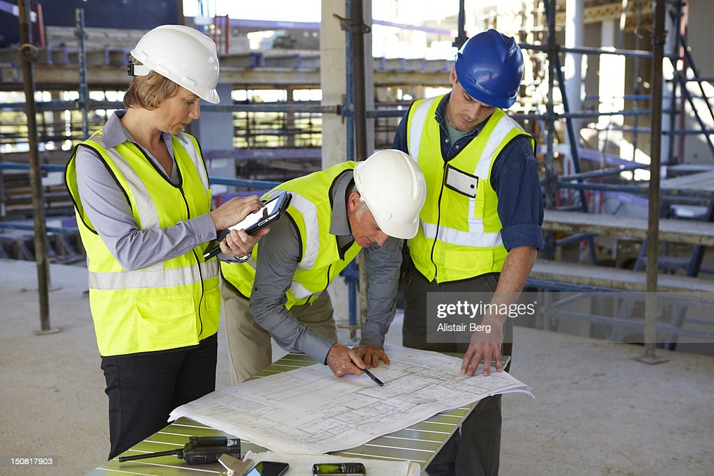 Building professionals meeting on site : Stock Photo