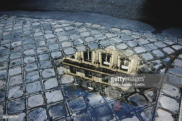 Building Reflection In Puddle
