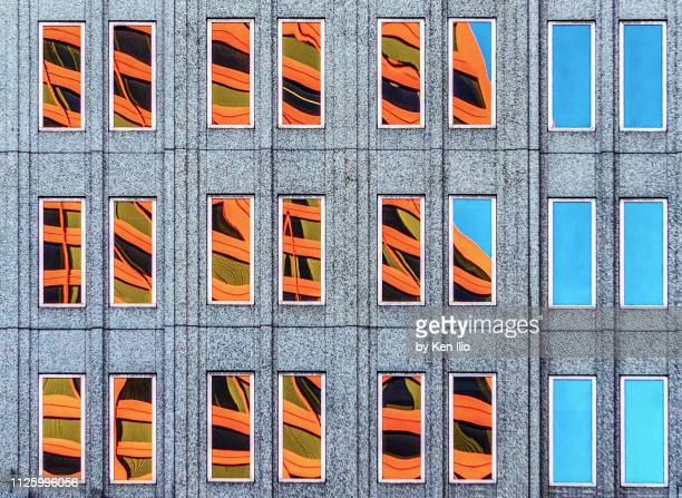 building reflection on window - ken ilio stock photos and pictures