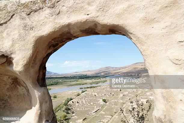 Building ruins framed by carved window at Uplistsikhe Cave Complex, Uplistsikhe, Georgia
