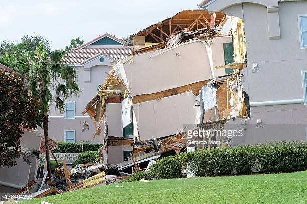 A building sits partially collapsed over a sinkhole at Summer Bay Resort near Disney World on August 12 2013 in Clermont Florida The 40 to 60 foot...