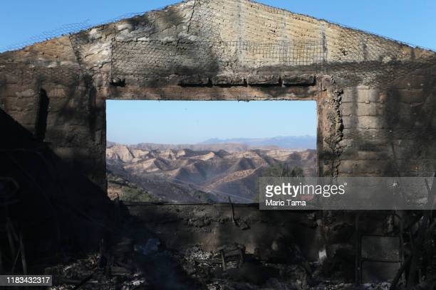A building stands burned by the Tick Fire with charred landscape in the distance on October 25 2019 in Canyon Country California The fire has burned...