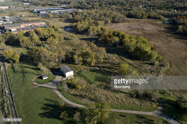 A building stands over a water monitoring well at a 3M Co disposal site in this aerial photograph taken over Oakdale Minnesota US on Thursday Oct 18...