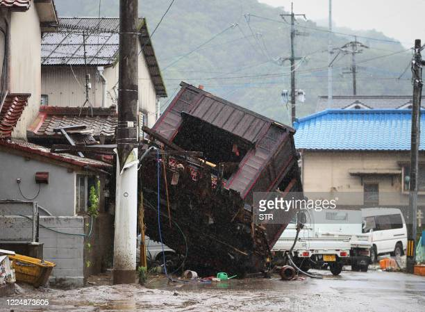 Building structure washed away by flooding due to torrential rain is seen on a street in Hitoyoshi, Kumamoto prefecture on July 5, 2020. - The floods...