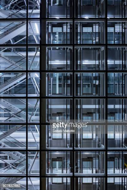 building structures appear through curtain wall
