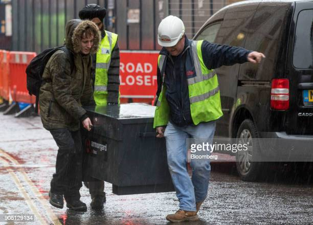 Building subcontractors working for MJ Hillson Ltd remove tools from the Barts Square development operated by Carillion Plc in London UK on Monday...