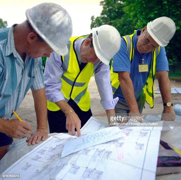Building technicians looking at plans Housing development England
