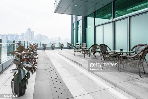 building terrace against chongqing skyline - building terrace stock pictures, royalty-free photos & images