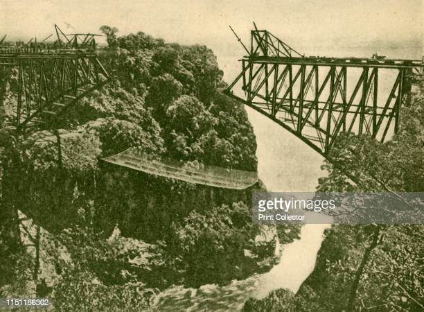 """Building the Zambesi Railway Bridge', circa 1930. From """"The Wonder Book of Engineering Wonders"""", edited by Harry Golding. [Ward, Lock & Co., Limited,..."""