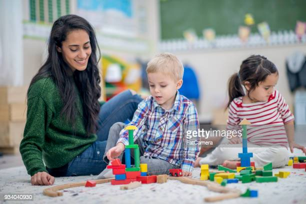 building together - nanny stock photos and pictures