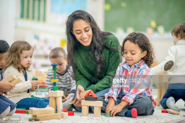 building together - preschool stock pictures, royalty-free photos & images