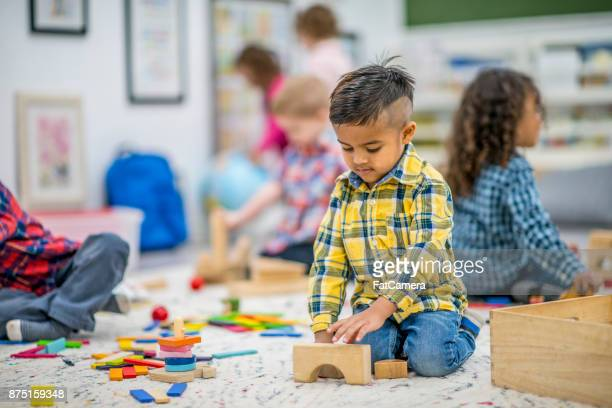 building towers - muslim boy stock photos and pictures