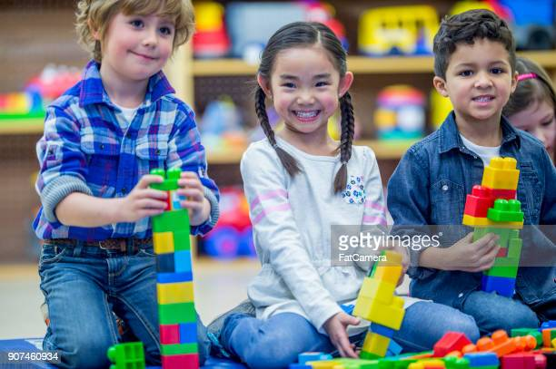 building towers together - tower stock pictures, royalty-free photos & images