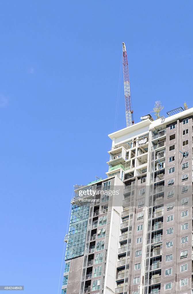 Building under construction with blue sky background : Stock Photo