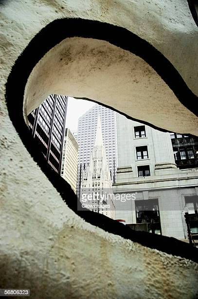 Building viewed through a hole in a modern sculpture, Chicago, Illinois, USA