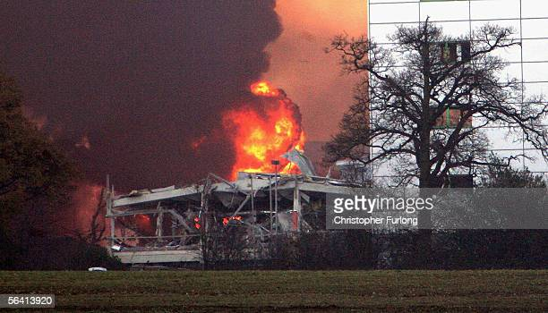 A building with all it's windows blown out is shown next to flames and plumes of smoke as they rise from Bruncefield oil depot on December 11 2005 in...