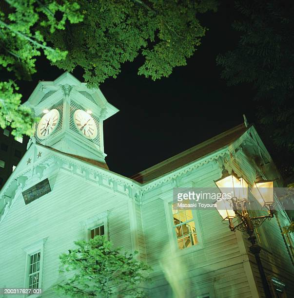 Building with clock tower, night, low angle view