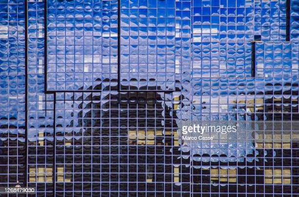 building with glass windows - built structure stock pictures, royalty-free photos & images