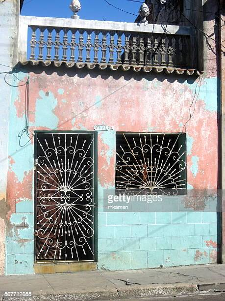 building with grilles, cienfuegos, cuba - metal grate stock pictures, royalty-free photos & images