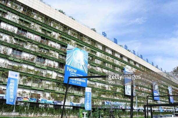 A building with plants covering on one wall is seen on November 25 2017 in Haining Zhejiang Province of China The green building in Haining is...